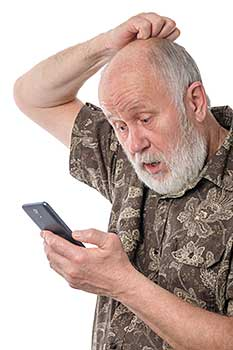 Senior man confused by smartphone
